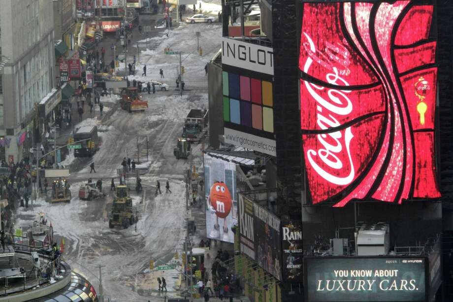 Front loaders are used to remove snow from Broadway north of New York's Times Square, Thursday in New York.  (AP Photo/Mary Altaffer) Photo: ASSOCIATED PRESS / AP2010
