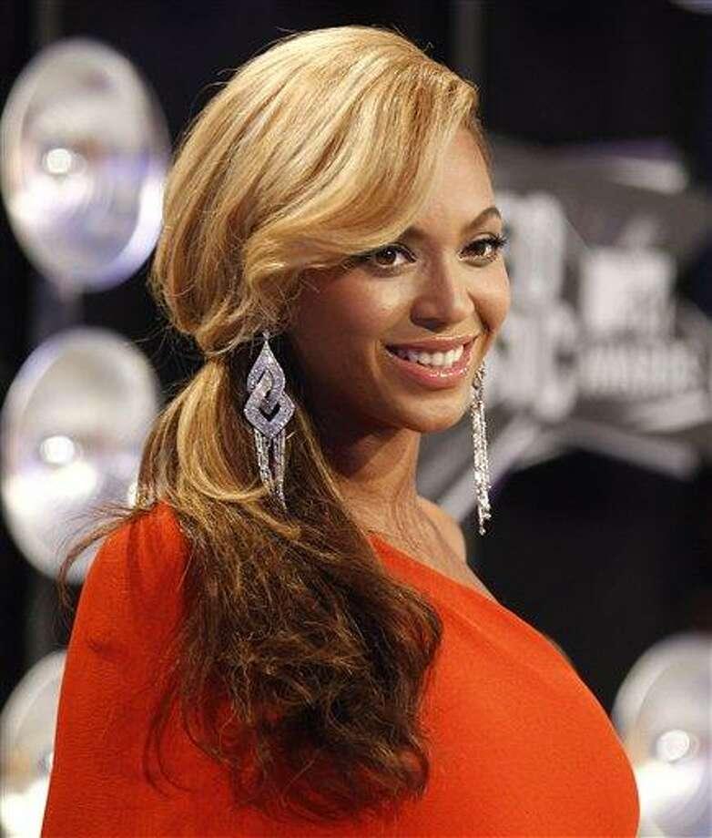 Beyonce arrives at the MTV Video Music Awards on Sunday Aug. 28, 2011, in Los Angeles. (AP Photo/Matt Sayles) Photo: AP / AP