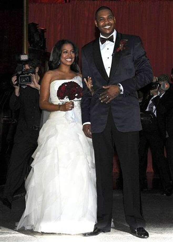 Carmelo Anthony and new bride LaLa pose for photographers after their wedding ceremony at Cipriani's, Saturday in New York. (AP) Photo: AP / FR77522 AP