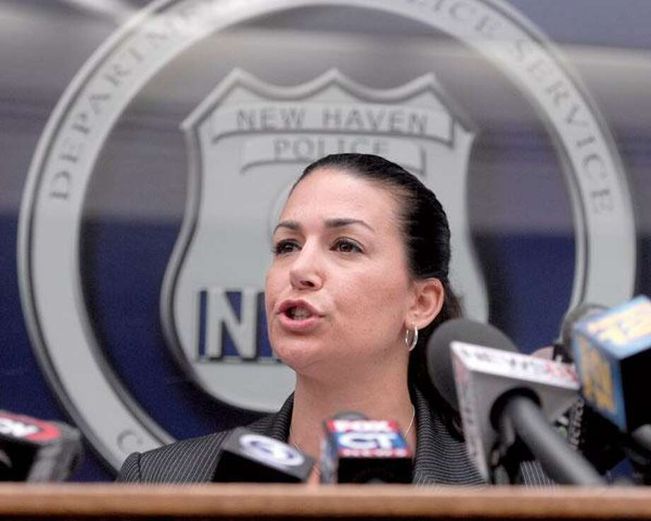 Lt. Julie Johnson, of the New Haven Police Department's Special Investigations Unit, addresses the media Saturday morning at New Haven Police headquarters about the arrest of a suspect in many east coast rapes. Aaron Thomas was arrested on Cooper Place Friday. (Brad Horrigan/New Haven Register)