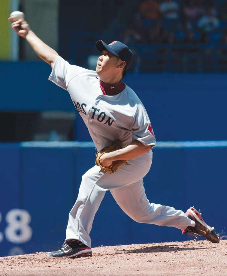 Boston Red Sox starter Daisuke Matsuzaka pitches during the fourth inning against the Toronto Blue Jays in a baseball game in Toronto on Sunday. (AP Photo/The Canadian Press, Frank Gunn) Photo: AP / The Canadian Press