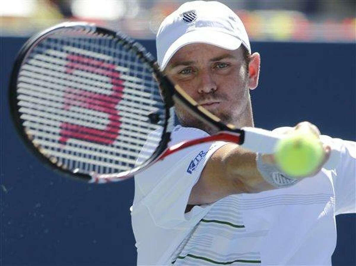 Mardy Fish returns a shot to Tobias Kamke of Germany during the first round of the U.S. Open tennis tournament in New York, Monday, Aug. 29, 2011. (AP Photo/Mike Groll)