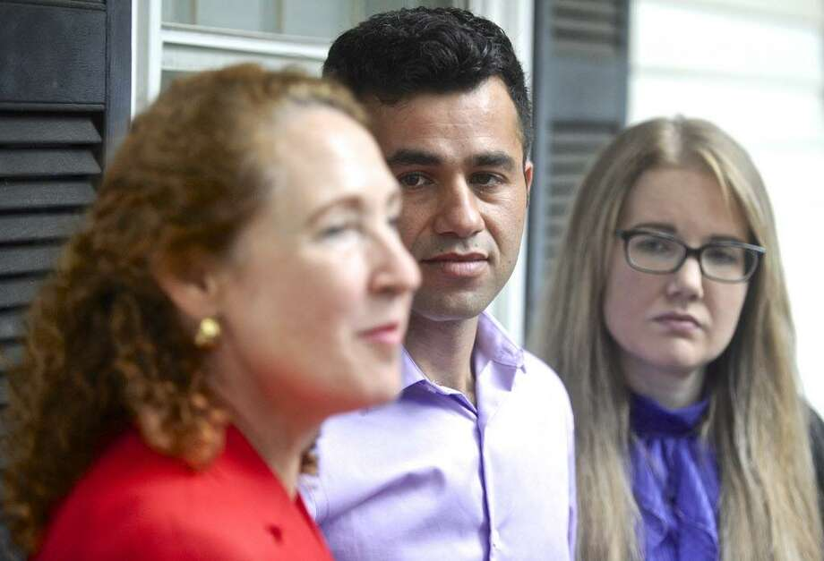 Joel Colindrés and his wife, Samantha, listen to Representative Elizabeth Esty during a press conference  at the Colindrés home on Monday afternoon. Colindrés was told July 20 during a meeting with U.S. Immigration and Customs Enforcement that he has to leave the country by Aug. 17. Monday, August 7, 2017, in New Fairfield, Conn. Photo: H John Voorhees III / Hearst Connecticut Media / The News-Times