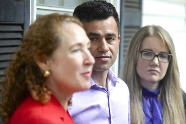 Joel Colindrés and his wife, Samantha, listen to Representative Elizabeth Esty during a press conference  at the Colindrés home on Monday afternoon. Colindrés was told July 20 during a meeting with U.S. Immigration and Customs Enforcement that he has to leave the country by Aug. 17. Monday, August 7, 2017, in New Fairfield, Conn.