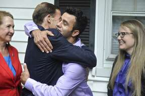 Joel Colindrés gets a hug from Sen. Richard Blumenthal after a July news conference at the Colindrés home . Rep. Elizabeth Esty and Colindrés wife, Samantha, look on. On Thursday, the day Colindres was to be deported, he received a stay allowing him to remain in the United States.