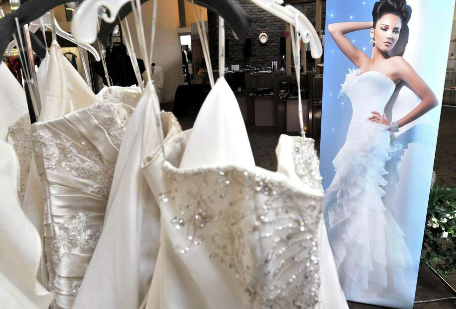Wedding dresses for sale are on display at Harold's Formal Wear in New Haven Wednesday.