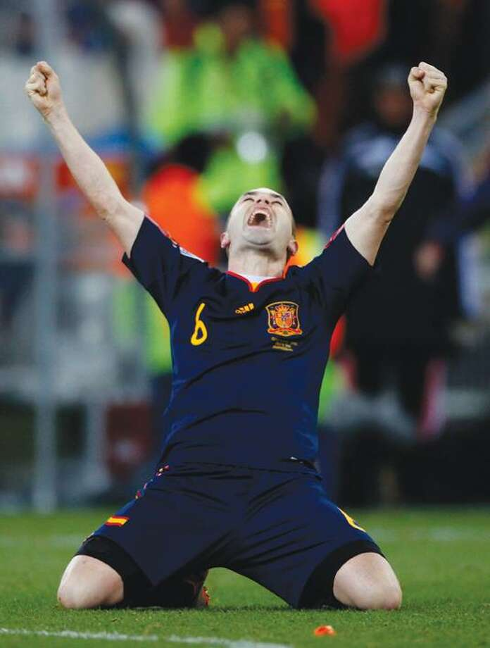 Spain's Andres Iniesta celebrates after  the World Cup final soccer match between the Netherlands and Spain at Soccer City in Johannesburg, South Africa, Sunday.  Spain won, 1-0. (AP Photo/Luca Bruno) Photo: AP / AP