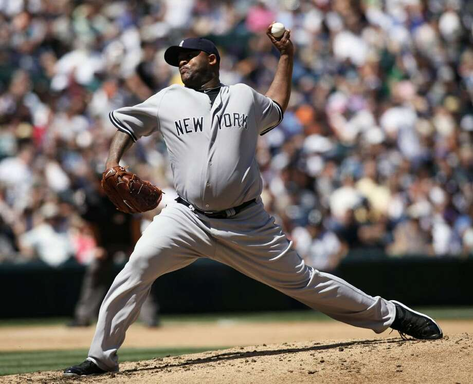 New York Yankees' CC Sabathia pitches to the Seattle Mariners during the fourth inning of a baseball game in Seattle on Sunday. (AP Photo/John Froschauer) Photo: AP / FR74207 AP