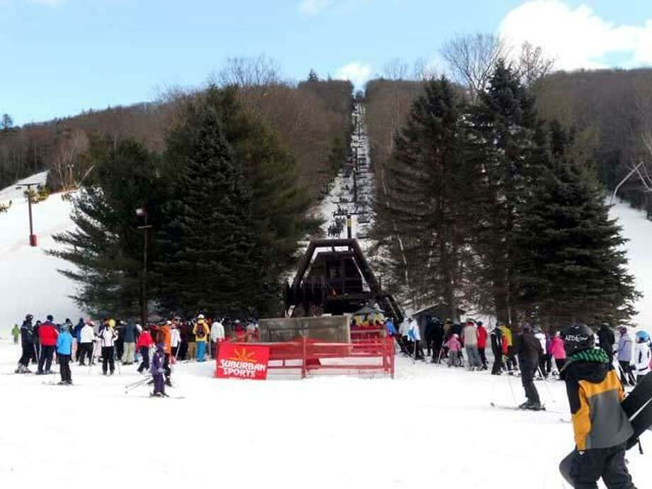 A line of skiers wait for the chair lift at Ski Sundown on Tuesday.