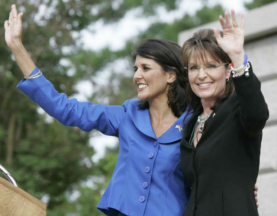 """FILE - In this May 14, 2010 file photo, former Alaska Gov. Sarah Palin waves to supporters after she endorses S.C. gubernatorial candidate Nikki Haley, left, during a campaign rally in Columbia, S.C. Sarah Palin is here to stay. A year after her abrupt resignation as Alaska governor, Palin has evolved into a political personality writ large, commanding weeks of headlines for a single Facebook observation _ see health care """"death panels"""" _ and six-figure speaking fees from groups clamoring for her words. Going rogue with a best-selling memoir only added to her aura among the conservative faithful and she has easily eclipsed other Republicans as the coveted endorsement this election year.  (AP Photo/Mary Ann Chastain, File) Photo: AP / FR170217 AP"""