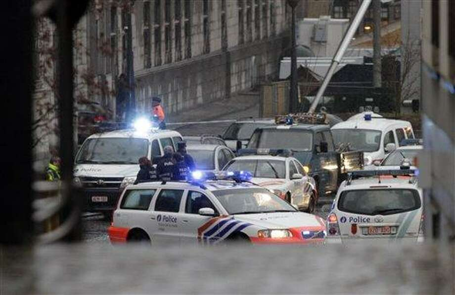 Ambulances are seen at the scene of incident in Liege, Belgium, Tuesday. Belgian news organizations are reporting that two people were killed and at least 10 wounded when three men attacked a crowd in the eastern Belgian city with hand grenades and gunfire. Associated Press Photo: ASSOCIATED PRESS / AP2011