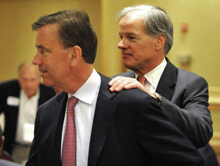 Gubernatorial candidate Ned Lamont, left, is greeted by fellow candidate Tom Foley in Stamford, Conn., on Tuesday, June 29, 2010. (AP Photo/Douglas Healey) Photo: AP / FR12849AP