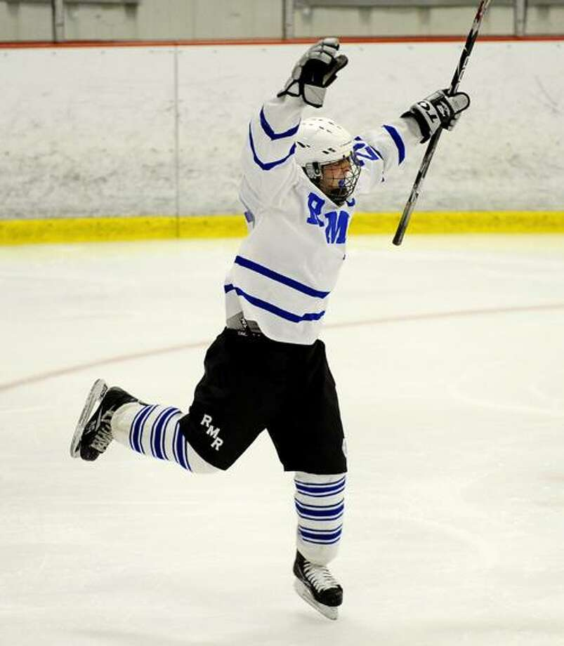 Steve McLaughlin PhotographyTaylor Laehy (23) reacts to scoring the first goal of the game for Rocky Hill/Middletown/RHAM boy's hockey.  Wethersfield defeated RMR in overtime 2-1.
