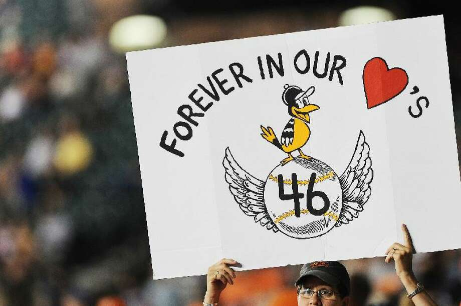 ASSOCIATED PRESS Gina Mast, of Baltimore, holds up a sign honoring Baltimore Orioles former player, coach, and executive Mike Flanagan, as the Orioles play the New York Yankees during Friday's game in Baltimore.