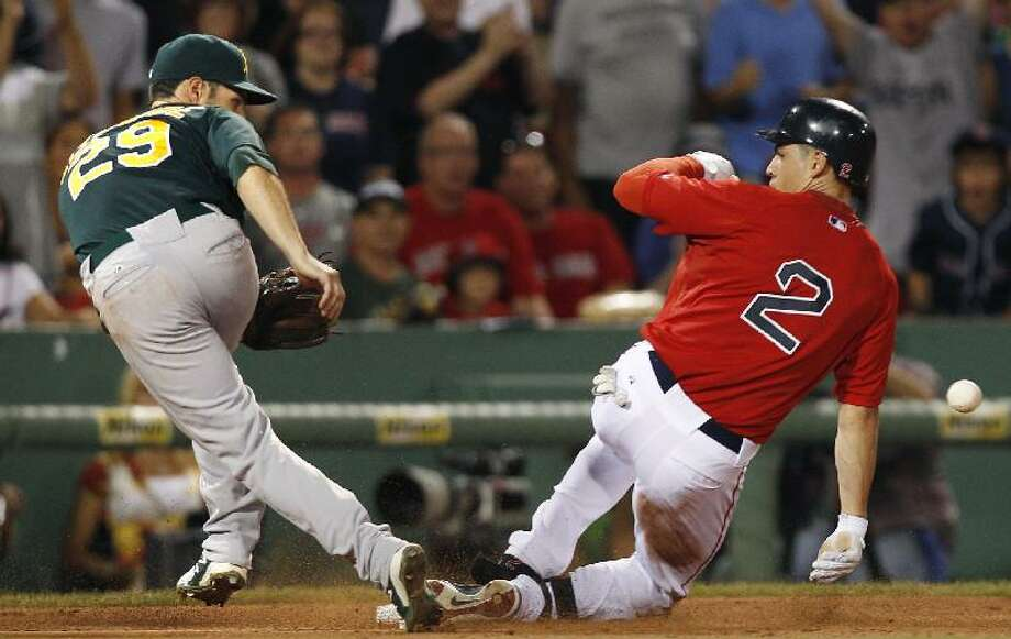 ASSOCIATED PRESS Boston Red Sox center fielder Jacoby Ellsbury, right, beats the throw as Oakland Athletics third baseman Scott Sizemore fields the ball on a triple in the fifth inning of Friday's game at Fenway Park in Boston.