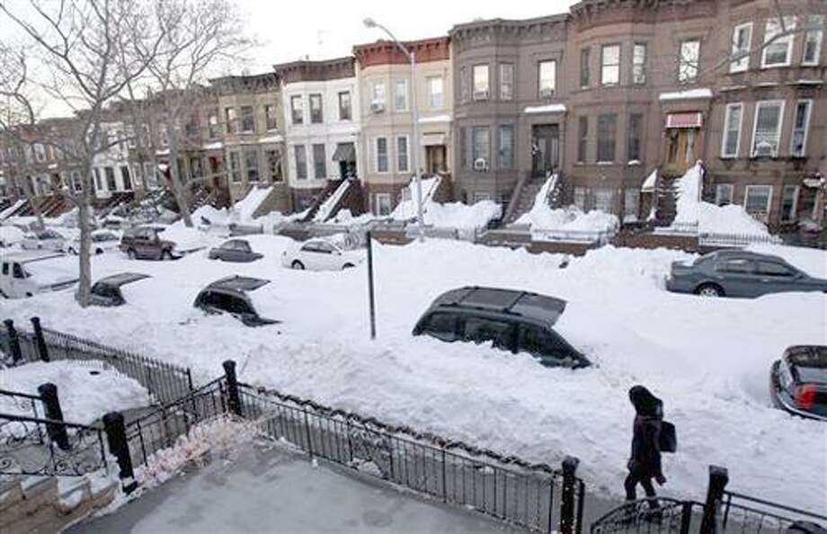 While most residents had cleared yards and sidewalks, many streets remained unplowed in the Sunset Park section of Brooklyn, N.Y., Tuesday, Dec. 28, 2010.  (AP Photo/Seth Wenig) Photo: AP / AP