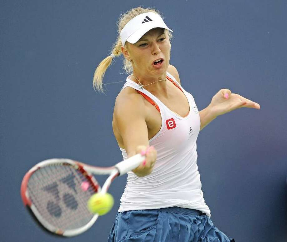 ASSOCIATED PRESS Caroline Wozniacki, of Denmark, hits a forehand return during her match against Petra Cetkovska, of the Czech Republic, in the finals of the New Haven Open tennis tournament in New Haven on Saturday.