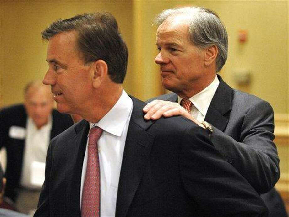 Gubernatorial candidate Ned Lamont, left, is greeted by fellow candidate Tom Foley in Stamford, on June 29. Photo: ASSOCIATED PRESS / FR12849AP