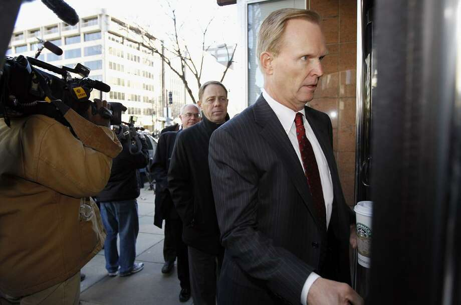 NFL spokesman Greg Aiello, left, Executive Vice-President and General Counsel Jeff Pash, arrive for football labor negotiations with the NFL players involving a federal mediator in Washington Thursday, March 3, 2011.(AP Photo/Alex Brandon)