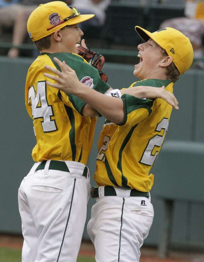 ASSOCIATED PRESS Huntington Beach, Calif., pitcher Trevor Windisch, right, celebrates with Hagen Danner after beating Billings, Mont., 11-2 in the U.S. Championship baseball game at the Little League World Series in South Williamsport, Pa., Saturday. California faces Japan in the World Championship game Sunday.