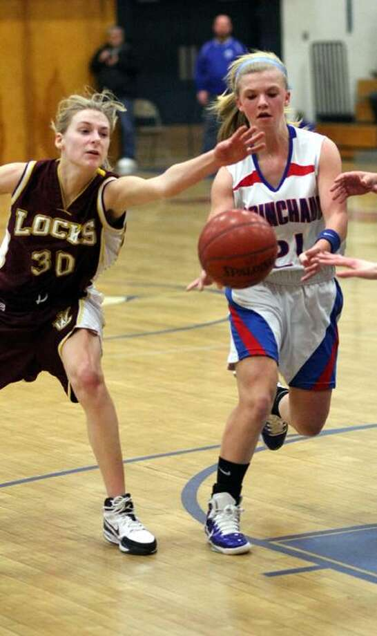 Todd Kalif/Special to The Press Coginchaug freshman Kim Romanoff passes the ball to one of her teammate's in last night's Class S State Tournament game against Windsor Locks in Durham.
