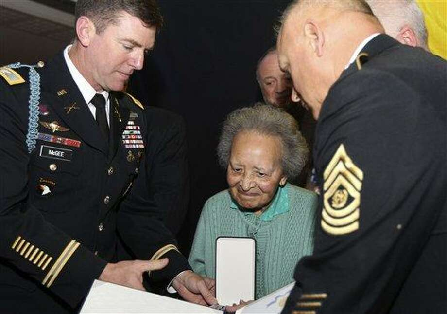 Belgian nurse Augusta Chiwy, center, who saved hundreds of wounded GIs during the WWII Battle of the Bulge, receives an award for valor from the U.S. Army, in Brussels Monday. The U.S. ambassador says there was a 67-year delay in presenting the award because it was assumed that Augusta Chiwy had herself perished in the battle. Associated Press Photo: AP / AP