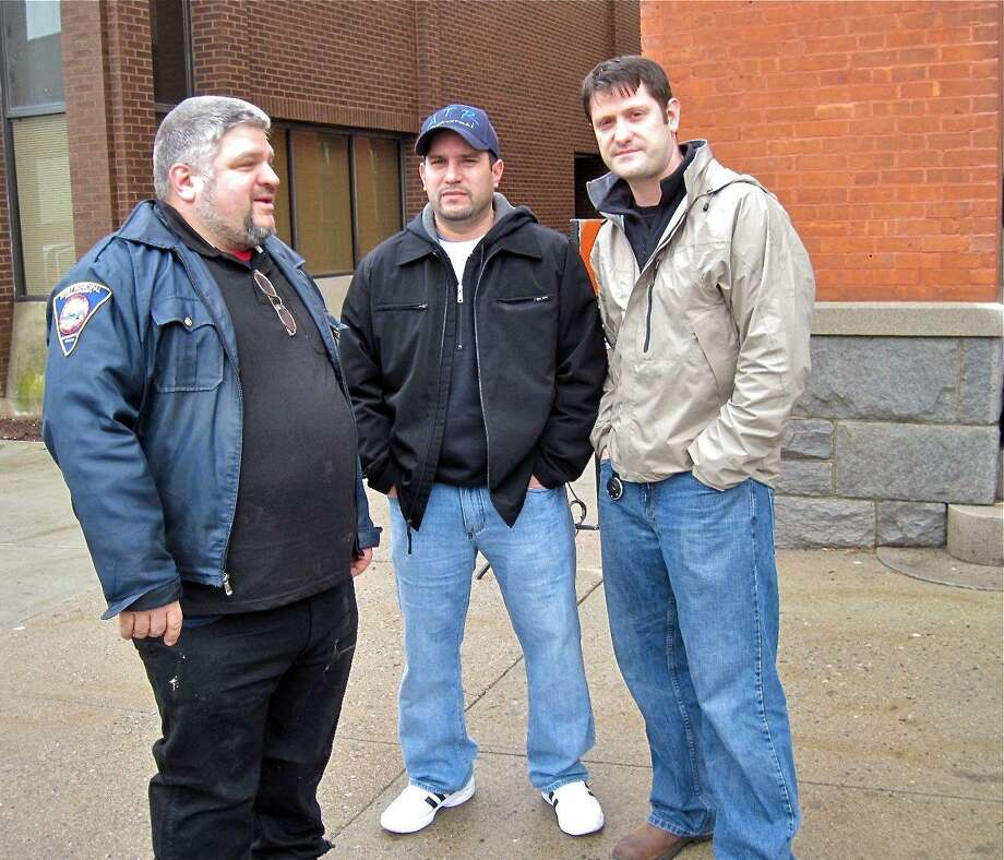 """(Patricia Villers/Journal Register News Service) Derby Cultural Commission Chairman Rich DiCarlo, left, and Dan Rivera, center, of Seymour, co-founder of Above the Realm paranormal investigative team, meet """"Ghost Hunters"""" co-star Grant Wilson in front of the Sterling Opera House in Derby on Monday."""