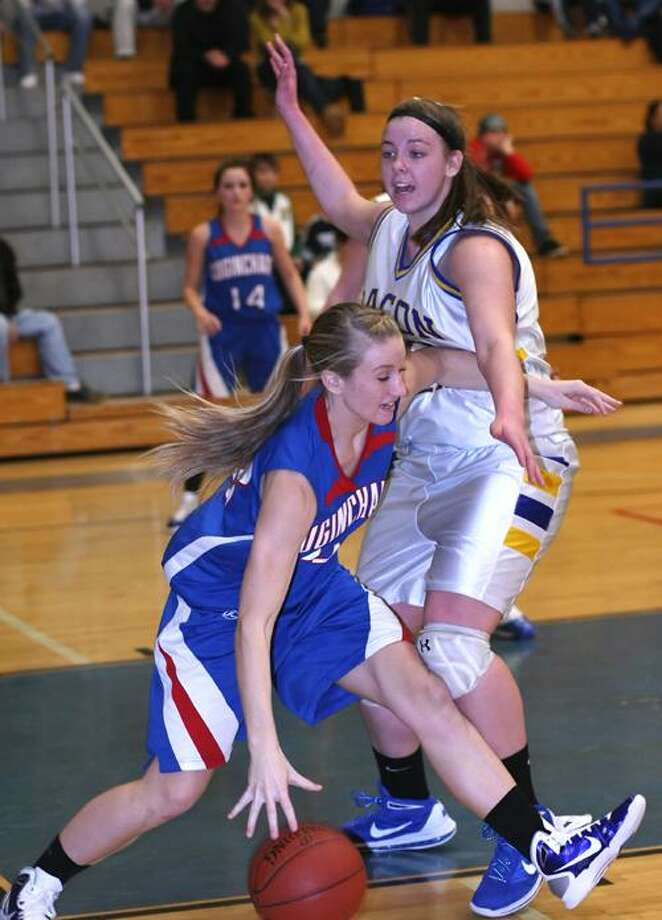 Special to the Press12.29.10 Coginchaug junior Lauren Esposito drives for the basket during Wednesday's game against Bacon Academy. Bacon defeated Coginchaug 64-40. To buy a glossy print of this photo and more, visit www.middletownpress.com
