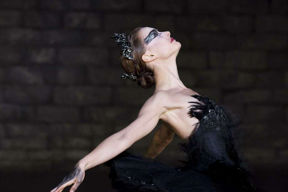 "In this picture Natalie Portman is shown in a scene from ""Black Swan."" Film critics are abuzz over actress Natalie Portman's work in the new big-screen ""Black Swan,"" but fashionistas are flipping over something else: the film's forward-thinking ballet costumes by Rodarte, sisters Laura and Kate Mulleavy.(AP Photo/Fox Searchlight, Niko Tavernise, FILE) Photo: ASSOCIATED PRESS / AP2010"