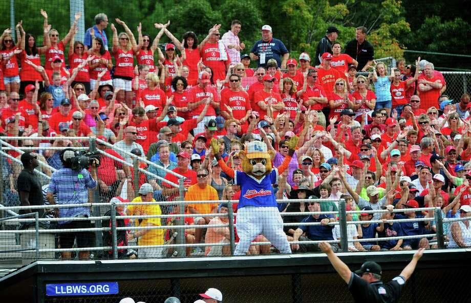 Fairfield American fans cheer on their team during the New England Region Little League championship. Fairfield won 10-0 to reach the Little League World Series. Photo: Christian Abraham / Hearst Connecticut Media / Connecticut Post