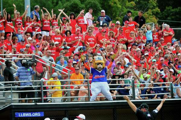 Fairfield American fans cheer on their team during the New England Region Little League championship. Fairfield won 10-0 to reach the Little League World Series.