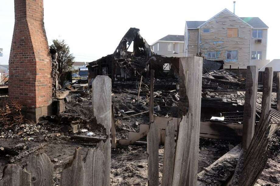 Two houses at the end of Beach Road West in the Chalker Beach area of Old Saybrook burned to the ground and a third sustained damage. Mara Lavitt/Register