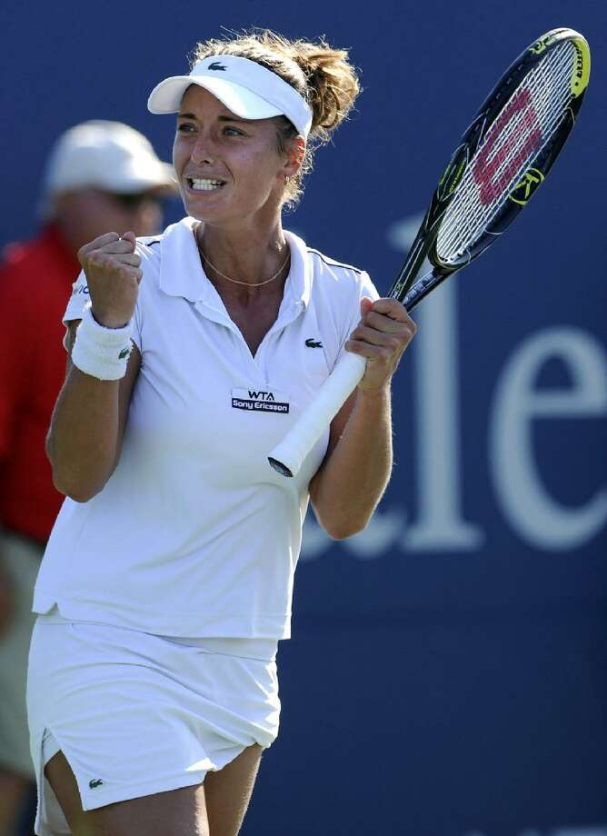 ASSOCIATED PRESS Petra Cetkovska, of the Czech Republic, celebrates after defeating Li Na, of China, 6-2, 5-7, 7-6 (9) in a semifinal match at the New Haven Open tennis tournament in New Haven on Friday.