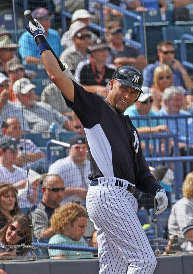AP New York Yankees shortstop Derek Jeter (2) warms up prior to his turn at bat against the Houston Astros, Wednesday in Tampa, Fla.