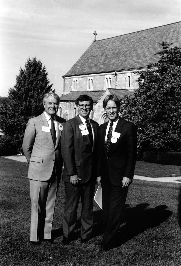 This Oct. 6, 1990 photo provided by the Canterbury School shows R. Sargent Shriver, left, Canterbury School Headmaster Thomas J. Sheehy III, and then president of Trinity College Tom Gerety, as they pose for a photograph in front of Canterbury School's Chapel of Our Lady during Canterbury's 75th anniversary celebration  in New Milford, Conn. Shriver served as master of ceremonies. (AP Photo/Canterbury School, Marc Vanasse) Photo: AP / Canterbury School