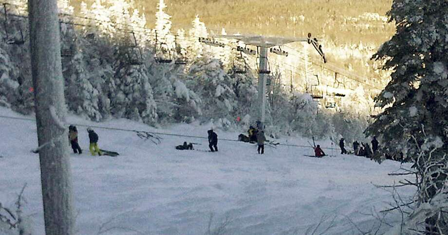 This photo provided by Al Noyes shows skiers and lift chairs on the slope after a lift derailed on the state's tallest ski mountain at the Sugarloaf resort in Carrabassett Valley, Maine, Tuesday.(AP Photo/Al Noyes) Photo: ASSOCIATED PRESS / AP2010