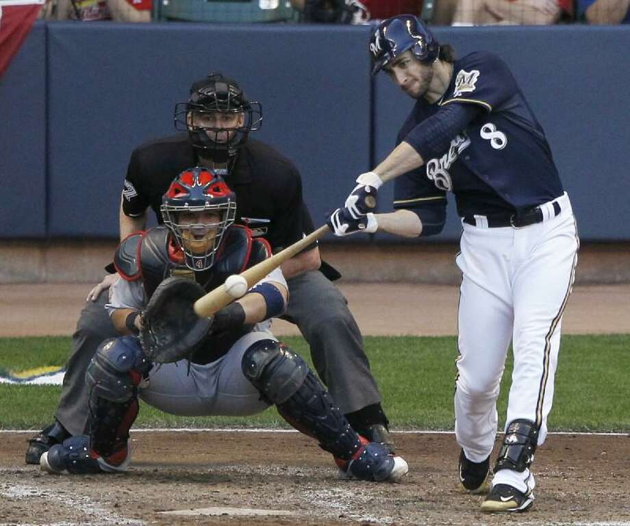 ASSOCIATED PRESS  Milwaukee Brewers slugger and 2011 National League MVP Ryan Braun, shown in the National League Championship Series against the St. Louis Cardinals, has tested positive for a performance-enhancing drug, according to multiple reports.