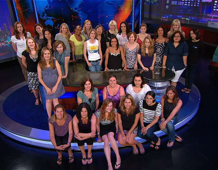 "In this undated publicity image released by Comedy Central, female staffers from the Comedy Central show ""The Daily Show with Jon Stewart,"" are shown on the set in New York. (AP Photo/The Daily Show with Jon Stewart, Comedy Central) Photo: ASSOCIATED PRESS / Comedy Central"