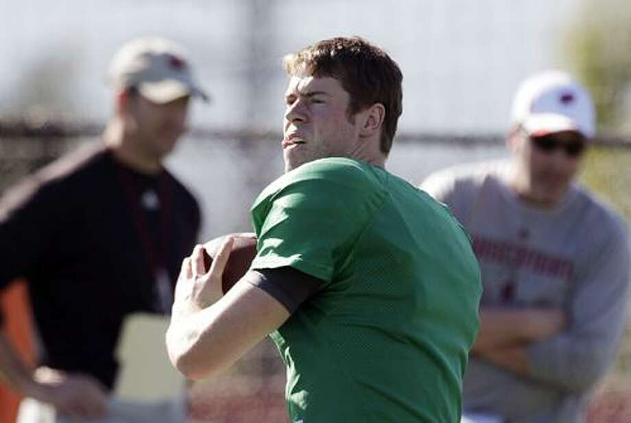 Wisconsin quarterback Scott Tolzien throws a pass during NCAA college football practice in Carson, Calif., Monday, Dec. 27, 2010. Wisconsin will face TCU in the Rose Bowl on New Year's Day in Pasadena, Calif. (AP Photo/Jae C. Hong) Photo: AP / AP