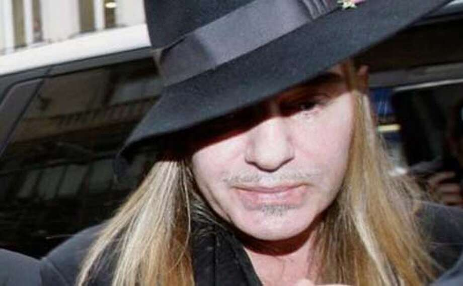 In this Monday, Feb. 28, 2011 file photo, Fashion designer John Galliano arrives at a police station in Paris. Christian Dior has fired Galliano in the wake of alleged anti-Semitic remarks he made during a dispute at a trendy Paris cafe.  (AP Photo)