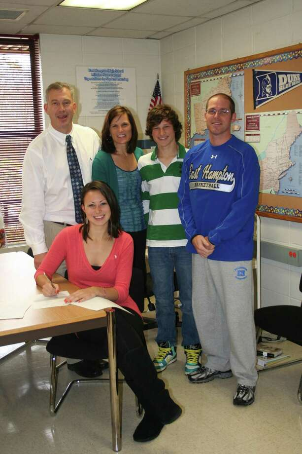 Courtesy of Barbara L.  Monarca Senior basketball player at East Hampton High School, Kelsey Booth, signed a letter of intent to play at Siena College located in Loudonville, New York. Kelsey was accompanied by her parents, Chris and Stacy as well as her brother Matt and Kelsey's high school coach and East Hampton Athletic Director, Shaun Russell as well as Principal Dr. Linda C. Berry and Assistant Principal, Don Gates.