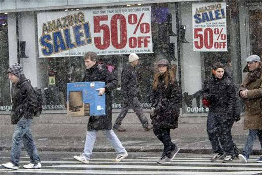 Shoppers make their way in the snow in Union Square, Sunday, Dec. 26, 2010 in New York.  (AP Photo/Mary Altaffer) Photo: AP / AP