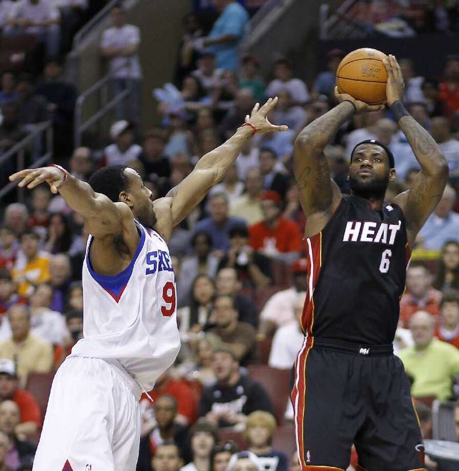 ASSOCIATED PRESS Philadelphia's Andre Iguodala, left, defends as Miami's LeBron James shoots a jumper during the first half of Game 4 of a first-round NBA playoff series on April 24 in Philadelphia.