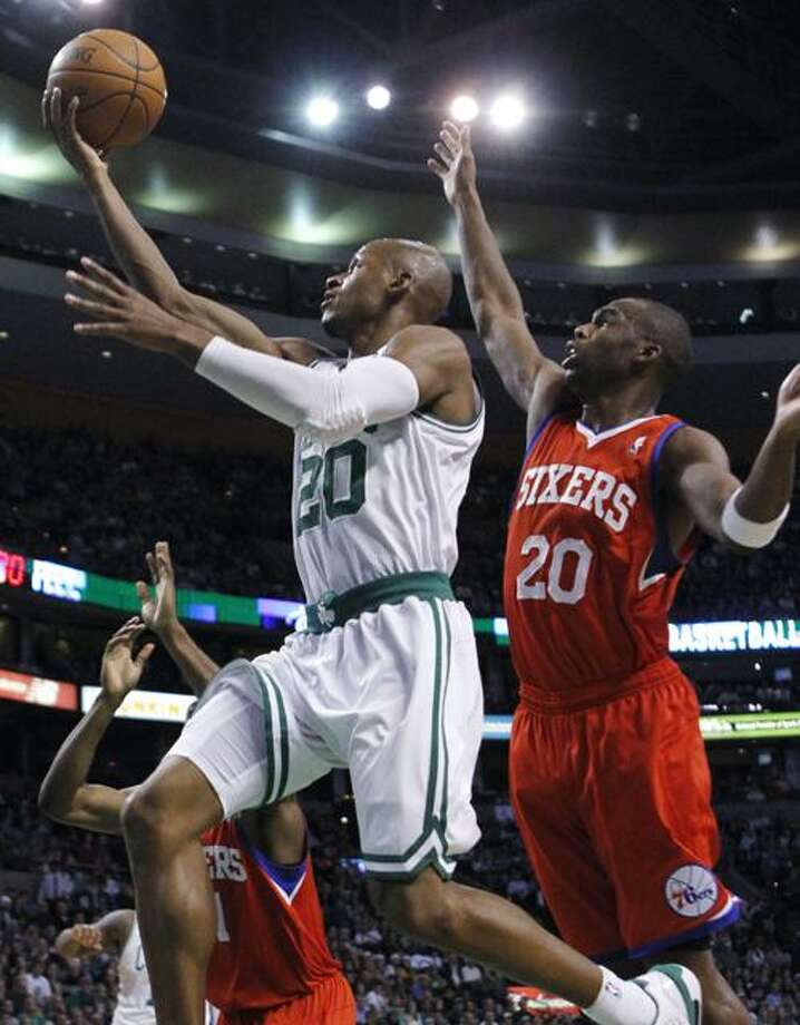 Boston Celtics' Ray Allen (20) shoots in front of Philadelphia 76ers' Jodie Meeks, right, in the first quarter of an NBA basketball game, Wednesday, Dec. 22, 2010, in Boston. (AP Photo/Michael Dwyer) Photo: ASSOCIATED PRESS / AP2010