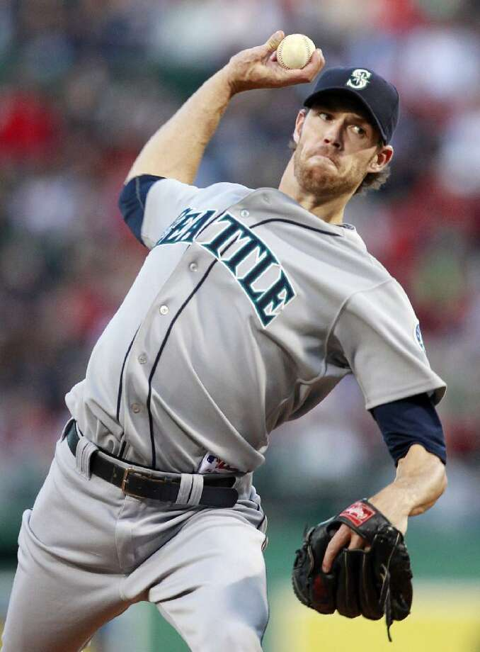 ASSOCIATED PRESS Seattle Mariners starter Doug Fister pitches in the first inning of Saturday's against the Boston Red Sox Saturday at Fenway Park in Boston. The Mariners won 2-0.