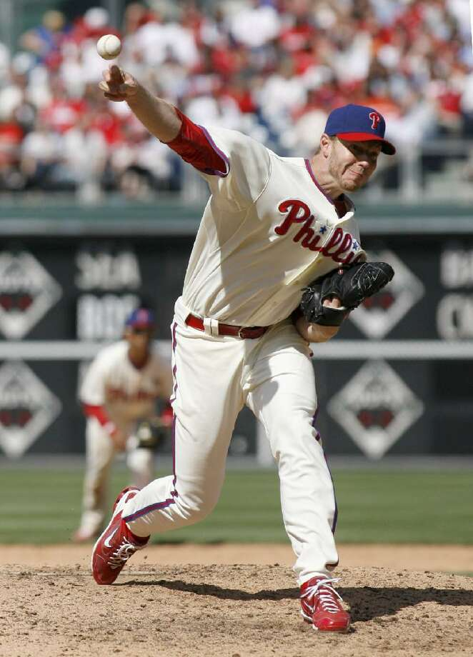 ASSOCIATED PRESS Philadelphia Phillies starter Roy Halladay pitches against the New York Mets in the ninth inning of Saturday's game in Philadelphia. The Phillies won 2-1.