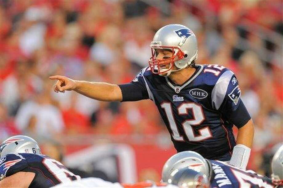 New England Patriots quarterback Tom Brady (12) during the Pats game against the Tampa Bay Buccaneers at Raymond James Stadium on Aug. 18, 2011 in Tampa, Fla. (AP Photo/Scott A. Miller) Photo: ASSOCIATED PRESS / AP2011