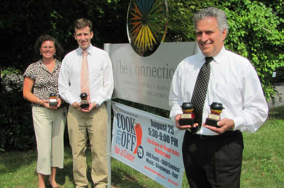 Submitted photo Heide Erb of The Connection, left, state Rep. Matt Lesser and Middletown Mayor Sebastian Giuliano hold trophies that will be awarded during the Second Annual Cook off for a Cause.