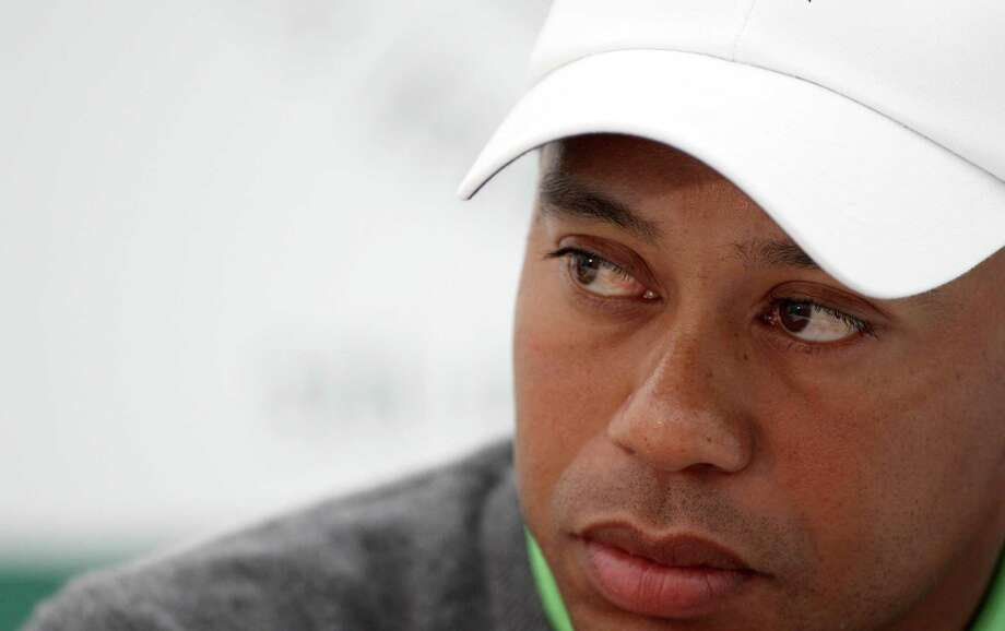 Tiger Woods pauses during a press conference after playing in the JP McManus Invitational Pro-Am at Adare Manor, Limerick, Ireland, Tuesday. (AP Photo/Peter Morrison) Photo: ASSOCIATED PRESS / AP