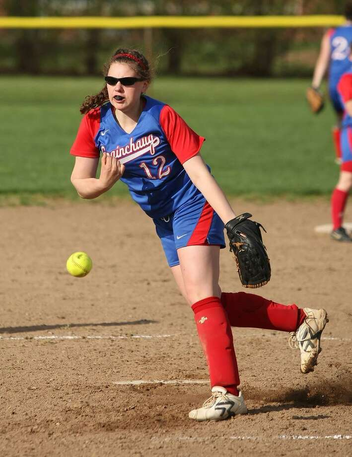 TODD KALIF/Press Correspondent Coginchaug starting pitcher Mari Handley takes a practice pitch between innings in Coginchaug softball's 17-4 win over Cromwell on Friday April 29.